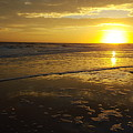 Sunset Over The Beach by Ami Brown