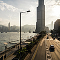 Sunset Over The Coastal Road Along The Victoria Harbour In Hong  by Didier Marti