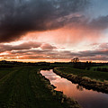 Sunset Over The River Wyre by Russell Millner