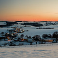 Sunset Over Winter Landscape by Manuel Posch