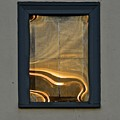 Sunset Reflection On Small Window by Tana Reiff