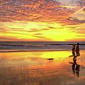 Sunset Ocean Runners by David Zanzinger