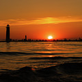 Sunset Silhouettes At Grand Haven Michigan by Dan Sproul