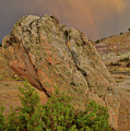 Sunset Storm Over Bentonite Site Boulders by Ray Mathis
