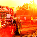 Sunset Tractor Pull by Olivier Le Queinec