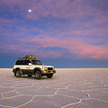 Lake Uyuni Sunset With Car by Aivar Mikko