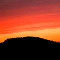 Sunsetting Over Forest Grove Mountains by Nick Gustafson