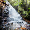Sunshine At The Waterfall by Debra and Dave Vanderlaan