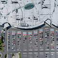 Supermarket Roof And Many Cars In Parking, Viewed From Above. by Mariusz Prusaczyk