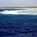 Surf Hits The Outer Reef At Rangiroa by Tim Laman