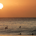 Surfers At Sunset by Vince Cavataio - Printscapes