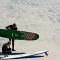 Surfing Couple by Robert VanDerWal