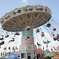 Swing Carousel At County Fair by William Kuta
