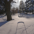 Swing Shadow On Snow by Steve Somerville