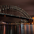 Sydney Harbor At Night With Train by John Daly