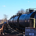 Tanker Cars Pulled By Csx Engines by William Rogers