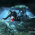 Technical Divers Enter The Cavern by Karen Doody