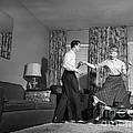 Teen Couple Dancing At Home, C.1950s by Debrocke/ClassicStock