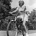 Teeng Girl Riding Bike On Sidewalk by H. Armstrong Roberts/ClassicStock