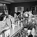 Teens At Soda Fountain Counter, C.1950s by H. Armstrong Roberts/ClassicStock