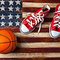 Tennis Shoes And Basketball On Flag by Garry Gay