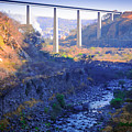 The Atenquique River Passes Under The Highway Bridge by Jorge Murguia