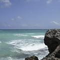 The Caribbean Sea Is Seen From A Rocky by Stephen Alvarez
