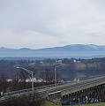The Catskill Mountains Escarpment Behind The Rip Van Winkle Bridge by Terrance DePietro