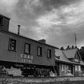 The Depot Under Cloudy Skies Black And White by Dale Kauzlaric