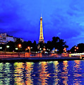 The Eiffel Tower Aglow by Don Mercer