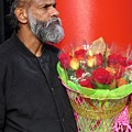 The Flower Vendor - Man Selling Roses by De Ann Troen
