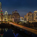 The Glimmering Neon Lights Of The Downtown Austin Skyscrapers Illuminate The Skyline Over Lady Bird Lake by Austin Bat Tours