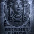 The Headstone Of Madame Leota by Mark Andrew Thomas
