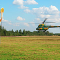 The Helicopter Over A Green Airfield. by Vadzim Kandratsenkau