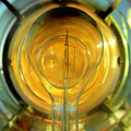 The Light Bulb Inside The Fresnel Of A Lighthouse by John Harmon