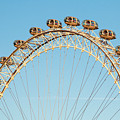 The London Eye Ferris Wheel Against A Cold Blue Winter Sky by Chris Warham
