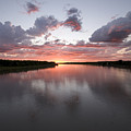 The Missouri River At Sunset Reflects by Phil Schermeister