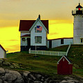 The Nubble Cape Neddick Lighthouse In Maine At Dawn by Chris Lord