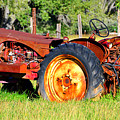 The Old Tractor In The Field by David Lee Thompson
