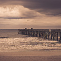 The Pier Before The Storm by Rodney  Perry