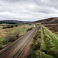 The Railroad To....in Scotland With Clouds Hanging Over The Mountains. by Ineke Mighorst
