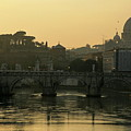 The Sant Angelo Bridge And The Papal Basilica Of Saint Peter At Sunset In Vatican City by Sami Sarkis