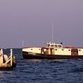 The Sonny S Ferry Docking At Middlebass Island by John Harmon