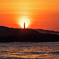 The Sun Rises Behind Thacher Light Rockport Ma by Toby McGuire