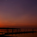 The Sun Sets Over The Water by Clayton Bruster