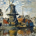 The Windmill On The Onbekende Gracht, Amsterdam 1874 by Claude Monet