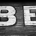 The Word Be Painted On The Side Of Old Building by John Harmon