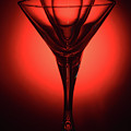 Three Empty Cocktail Glasses On Red Background by Oleg Yermolov