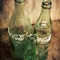 Three Vintage Coca Cola Bottles  by Terry DeLuco