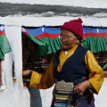 Tibetan Grandmother Turning The Prayer Wheel by Dagmar Batyahav